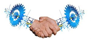 IMAGE: Shaking hands as virtual teams
